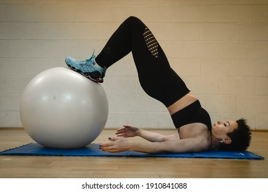 woman doing whit ball exercises, personal trainer online classes
