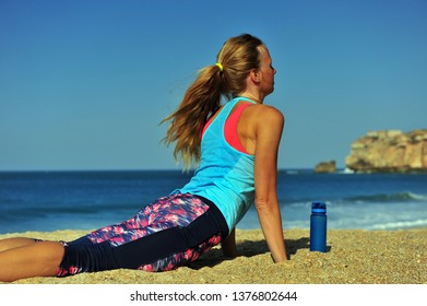 Woman doing workout on beach by the sea