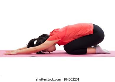 Woman doing yoga child pose isolated on white background