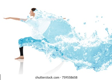 Woman doing yoga exercise in splashes of water.