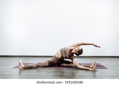 Woman doing yoga on the carpet doing stretching