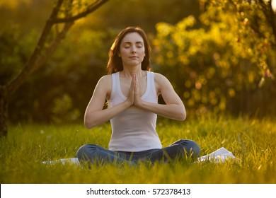 Woman doing yoga at park