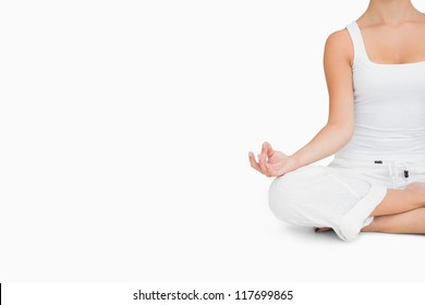 Woman doing yoga pose while sitting cross legged