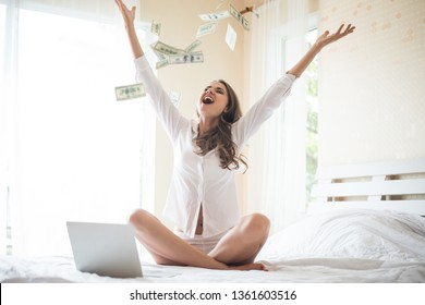 Woman with dollar bank note on the bed