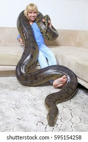 Woman with a domesticated anaconda