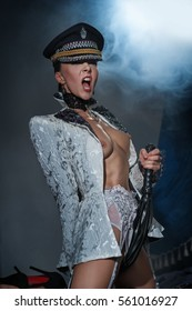 The woman - dominant with cap and whip