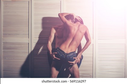 woman dominates the man on top of the girl BDSM sex games obeys man. Sexy woman playing with macho lovers body. The love story. Guy and girl posing together. Fashion shoot of a sexy couple.
