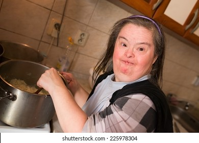 woman with down syndrome in kitchen