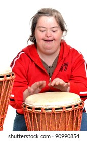 woman with down syndrome playing on djembe