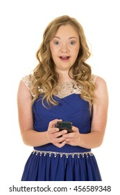 a woman with down syndrome using her phone to text with a shocked expression.