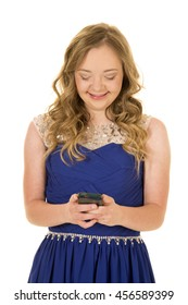 A woman with down syndrome using her phone to send a text, with a smile.