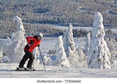 Woman downhill skiing