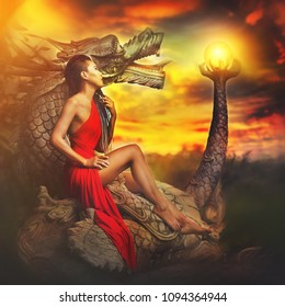 Woman with dragon statue what hold magic ball crystal, creative post production