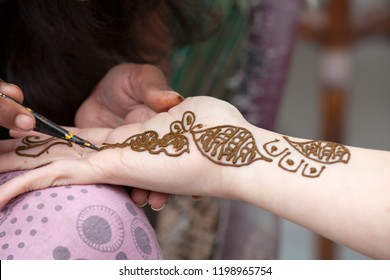 Woman Drawing a Henna Tattoo