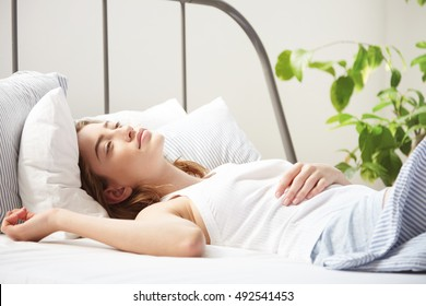 woman dreaming in bed in the morning