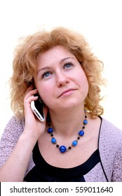 woman dreaming and talking on the phone