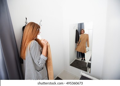 Woman with dress in the checkroom
