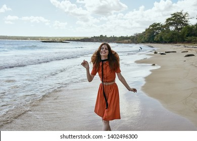 woman in dress happy running along the beach on the sand Ocean sea nature island
