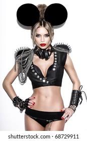 A woman dressed as a fashion  cartoon mouse with big ears.  Fashion art photo