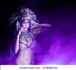 Woman dressed as an Indian poses as a model amidst long exposure lights