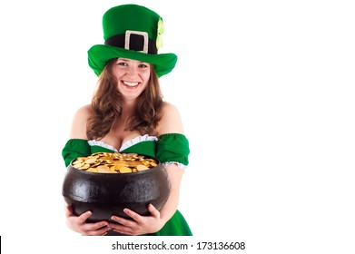 woman dressed as a leprechaun with a pot of gold in hands
