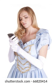 A woman dressed like Cinderella looking at her cell phone.