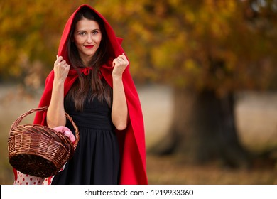 Woman dressed as Red Riding Hood in various postures in the forest