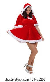 Woman dressed in a sexy Mrs. Claus costume