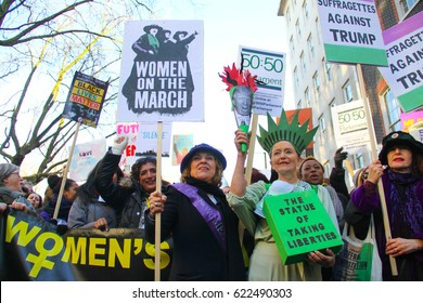 A woman dressed as the statue of liberty with others dressed as suffragettes at the Women's March in London. The march was on the first full day of Donald Trump's presidency on January 21, 2017.