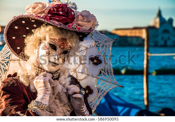 Woman dressed in traditional costume in Venice during the Carnival