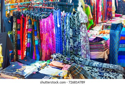 Woman dresses and t-shorts and pants for sell at night market. Chiang Mai, Thailand