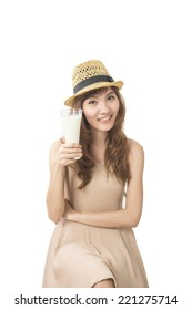 woman drink a glass of milk on white