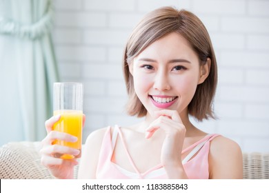 woman drink juice and feel happily at home