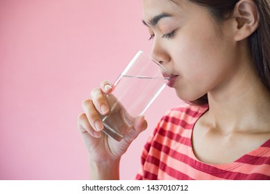 woman drink water after take a medicine