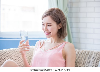 woman drink water and feel happily at home