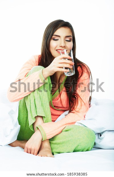 Woman drink water. Female model hold water glass.