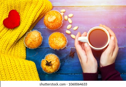 woman drinking arabic coffee and muffins decorated with cotton heart and peanuts and star anise