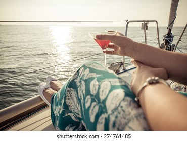 woman drinking cocktail on the boat. concept about leisure, summer, vacations and people