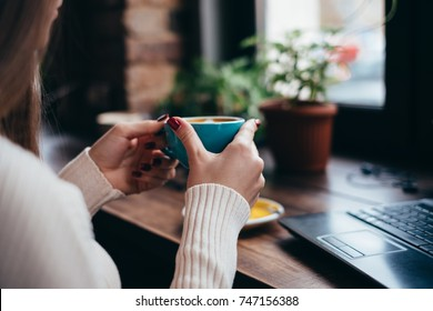Woman drinking coffee after work