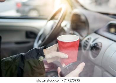 Woman drinking coffee in car