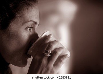 Woman Drinking coffee and Contemplating her life