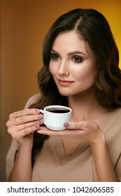 Woman Drinking Coffee. Female Drinking Hot Beverage.