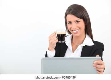 Woman drinking a coffee at her laptop
