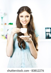 woman drinking coffee in the kitchen