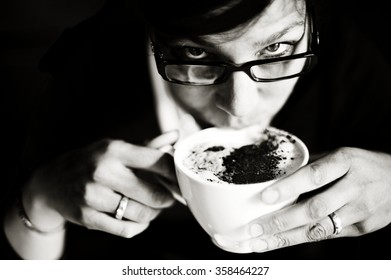 Woman drinking coffee - Monochrome image of woman enjoying a hot cup of coffee.