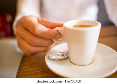 Woman drinking coffee in restaurant,cafe
