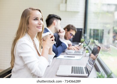 Woman drinking coffee while Work at office. Smiling Businesswoman work at office Concept.