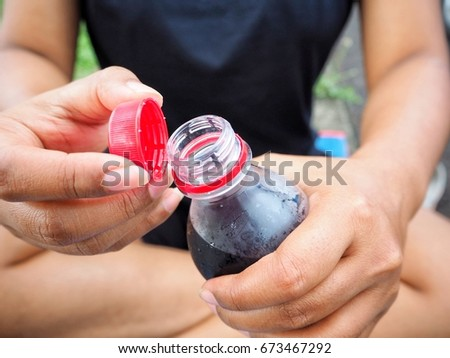 Woman drinking cola bottle