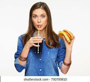 Woman drinking cola with burger. Fast food isolated on white.