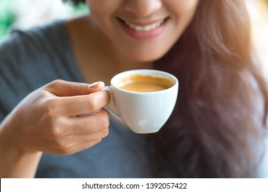 woman drinking espresso at coffee cafe.